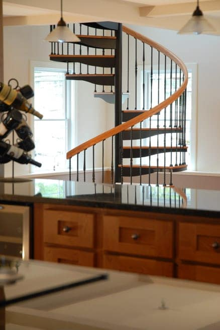 open floor plan with spiral staircase