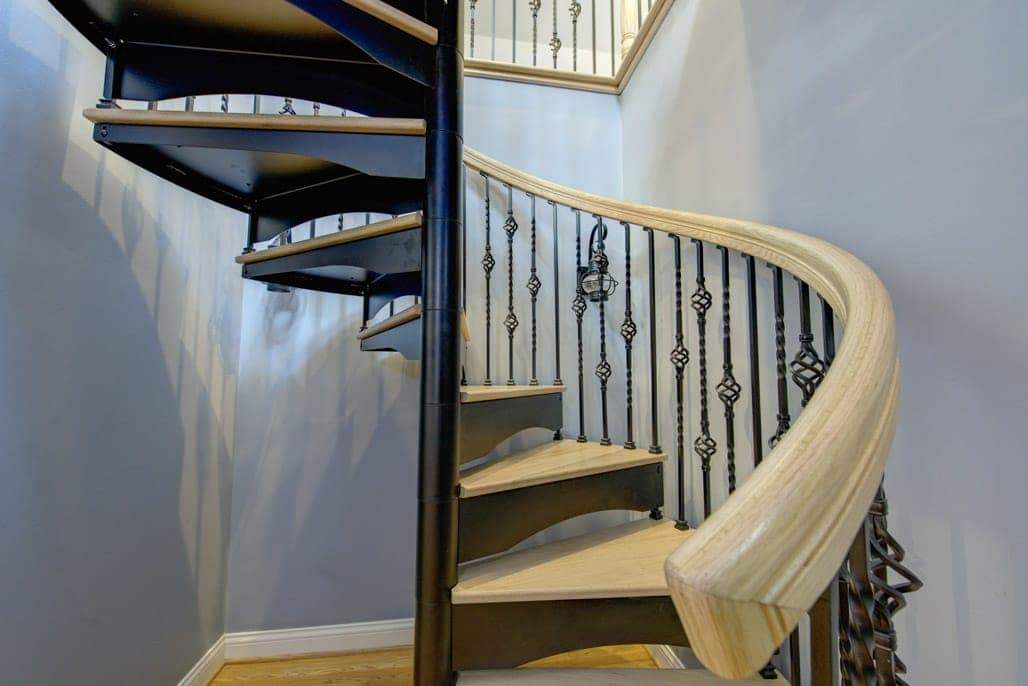 forged iron spiral stair with pine steps
