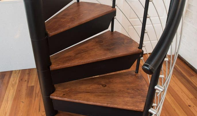steel spiral stair with wood accents