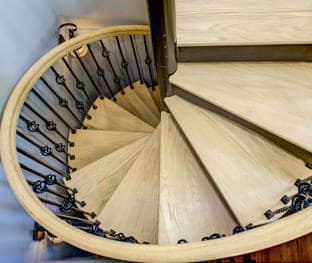 iron spiral stair with ornamental balusters