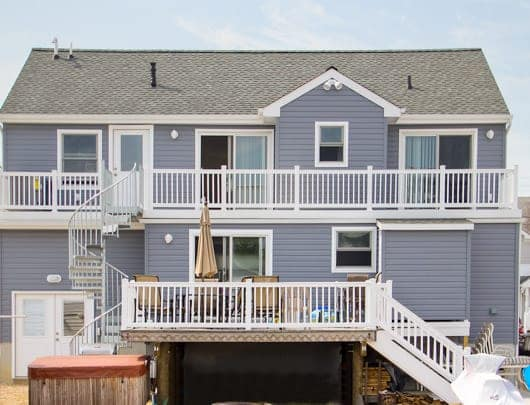beach house with multi level deck