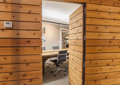 wood paneled doorway in modern office for Exscape Designs