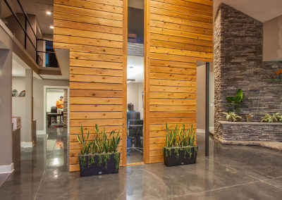 interior of office renovation for Exscape Designs with wod and stone walls