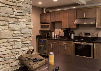 office kitchen with dark brown cabinetry