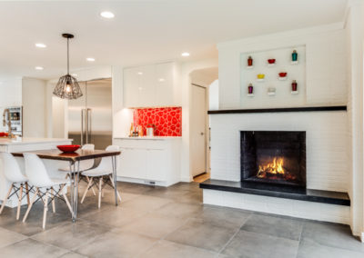 modern kitchen remodel with white brick fireplace