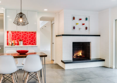 white brick fireplace in modern kitchen remodel
