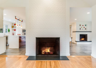 modern fireplace surround in high end home remodel