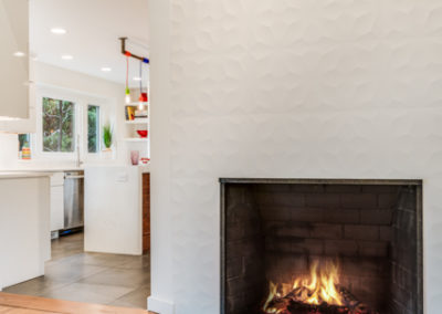 modern living room remodel with white fireplace surround