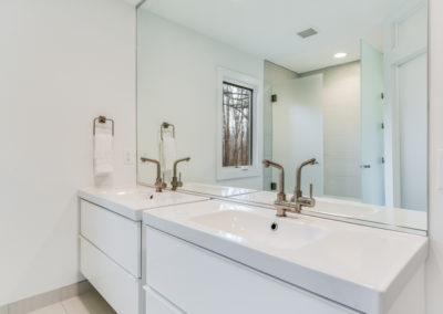 white bathroom remodel with double sink vanity