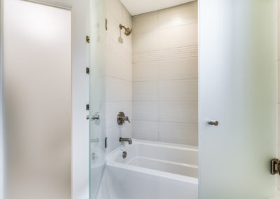 tub shower combination with frosted glass doors