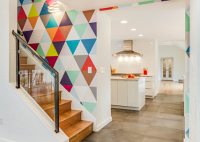 modern staircase renovation with colorful geometric wallpaper