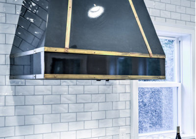black range hood with gold accents