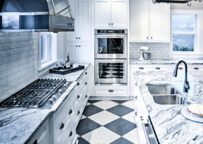 retro kitchen with black and white marbled counters