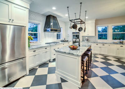 modern retro kitchen with black and white checkered floor