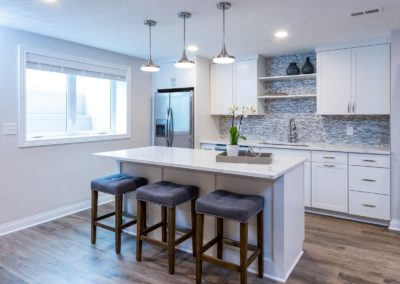 white kitchen with seating island