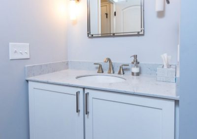 wall mounted single sink vanity with white cabinets