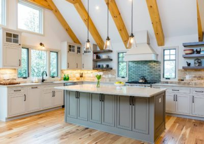 two toned gray and white kitchen with natural hickory hardwood floors