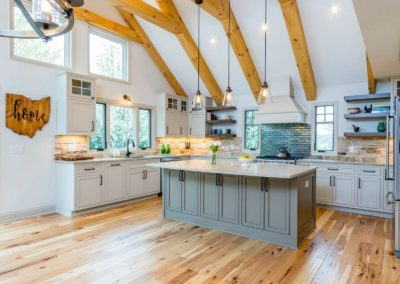 remodeled kitchen with vaulted ceiling and hickory hardwood flooring