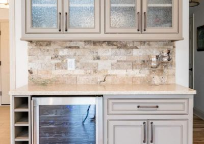 kitchen cabinets with frosted glass doors and mini-fridge