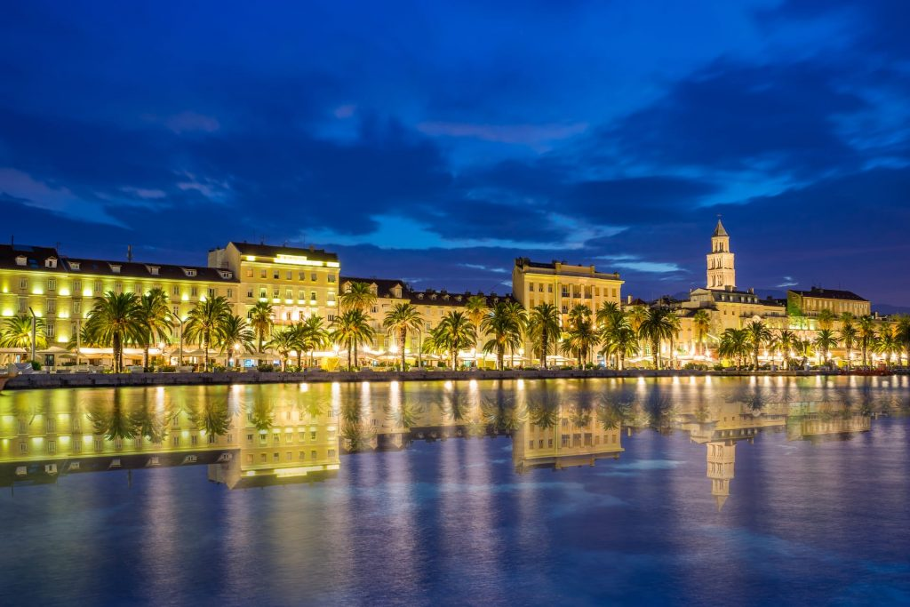 Evening viewof Split with Diocletian Palace and St Domnius Cathedral at blue hour with water reflection, Dalmatia, Croatia