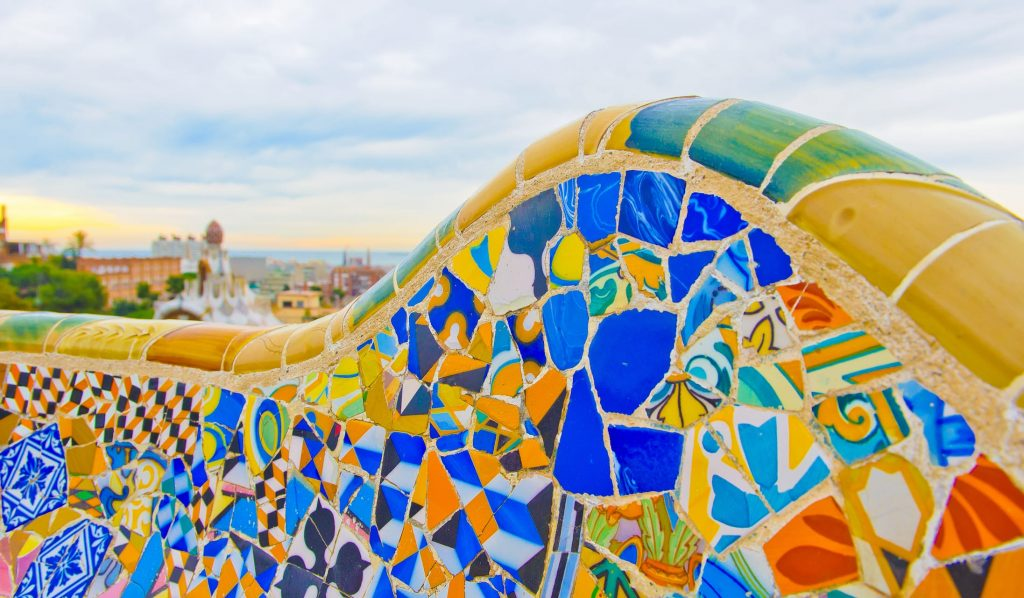 Details of a colorful ceramic bench at Parc Guell designed by Antoni Gaudi, Barcelona, Spain