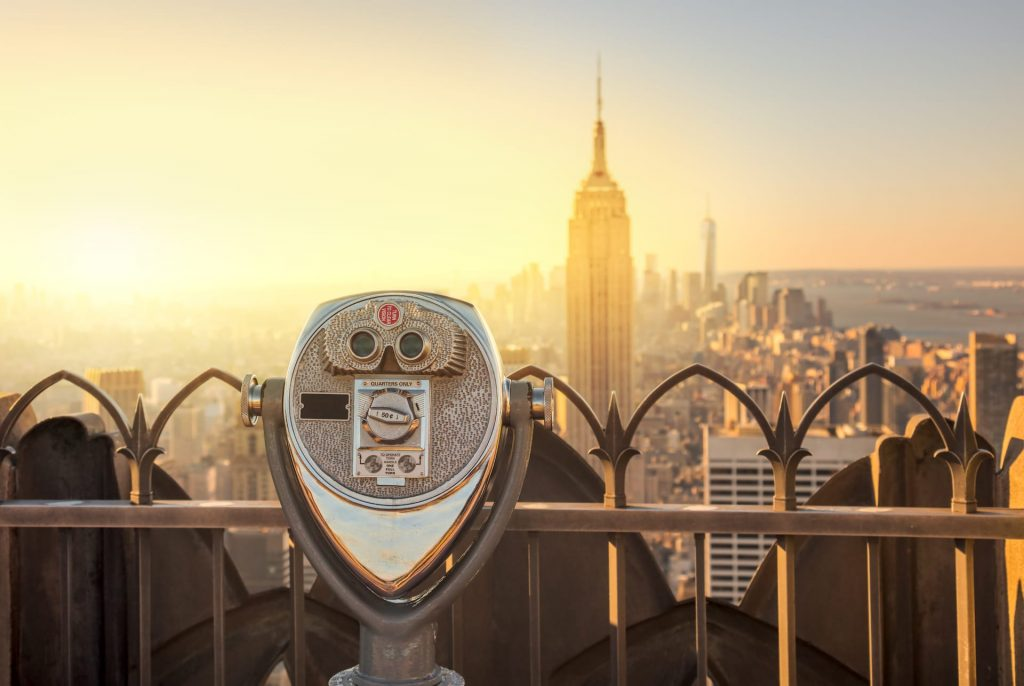 Tourist binoculars on Top of the Rock, overlooking the Manhattan skyline in New York City at the morning.