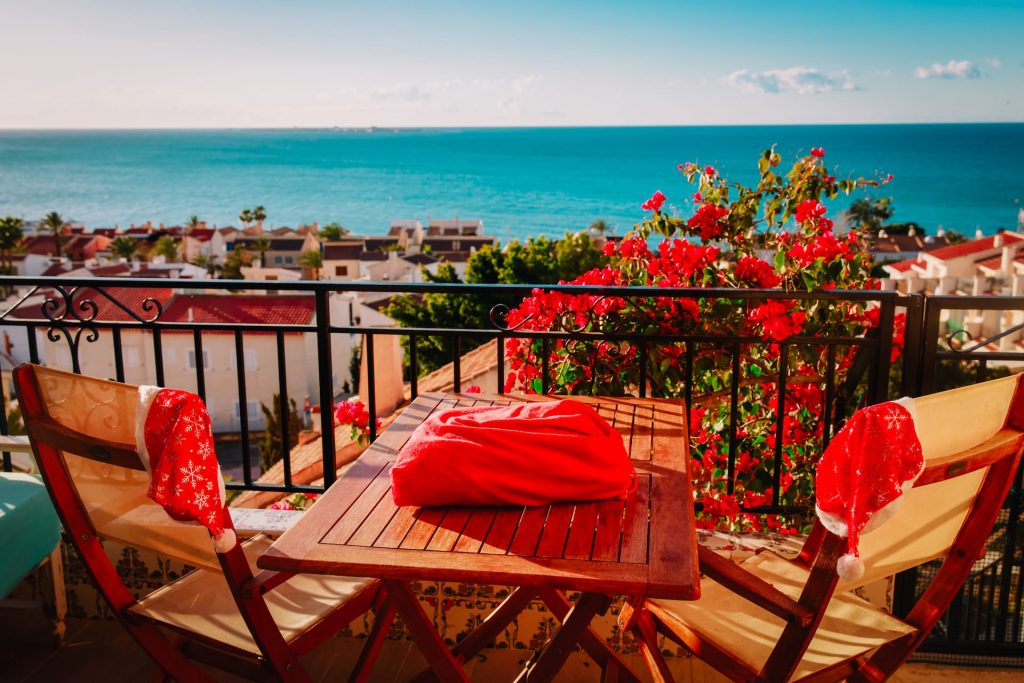 Christmas celebration on balcony terrace with sea view, winter travel