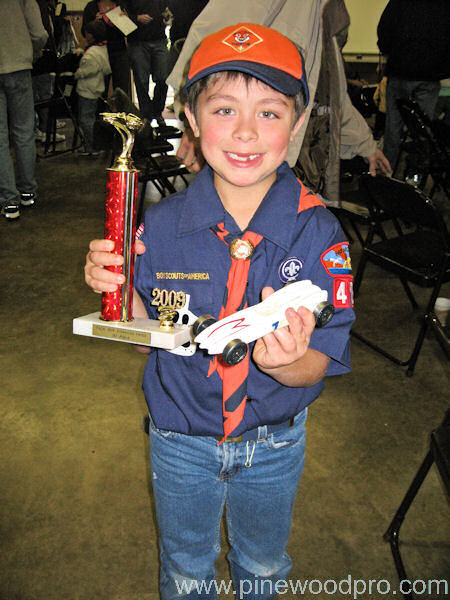 Boy Scout with Trophy and Car Design