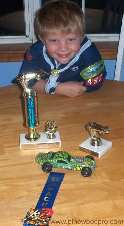 Pinewood Derby Winner with Trophies
