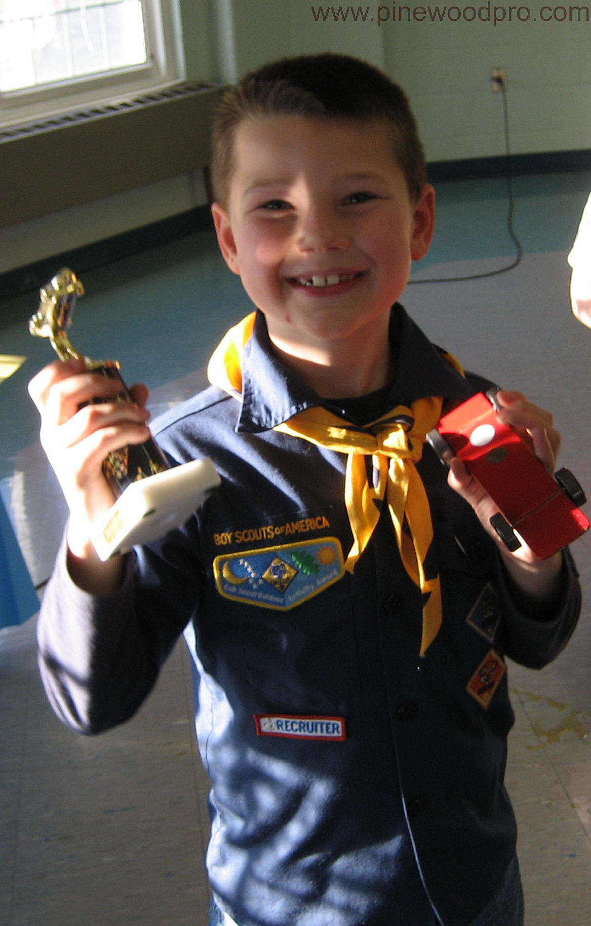 Boy Scout winner with Car and Trophy