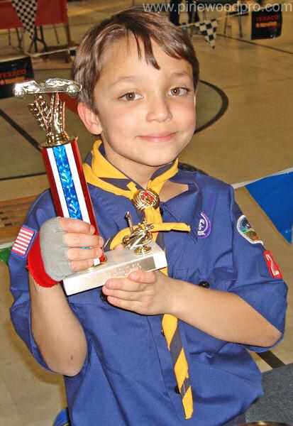 Pinewood Derby Winner with Trophy
