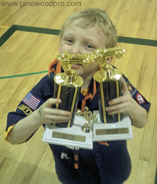 Pinewood Derby Winner with Two Trophies