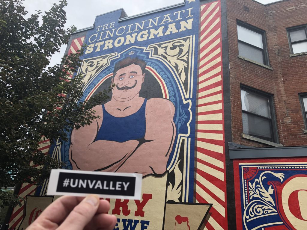 Cincinnati Strongman mural with #Unvalley sticker