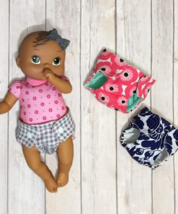 I'm sharing a how-to for cloth dolly diapers I made with this free dolls diaper pattern. Because even baby dolls can be environmentally friendly!