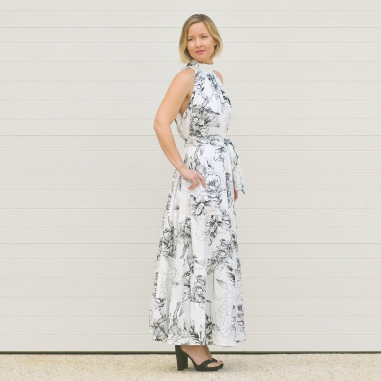 The Emma is a ladies high neck dress pattern that has a fitted neckband with a loose flared top, 5 length options from top to maxi, and an optional sash.