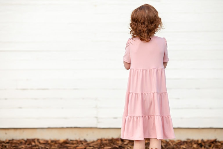If you liked our Paris Party Dress, then you will love this gorgeous childrens gathered dress sewing pattern for knits: The Paris Day Dress
