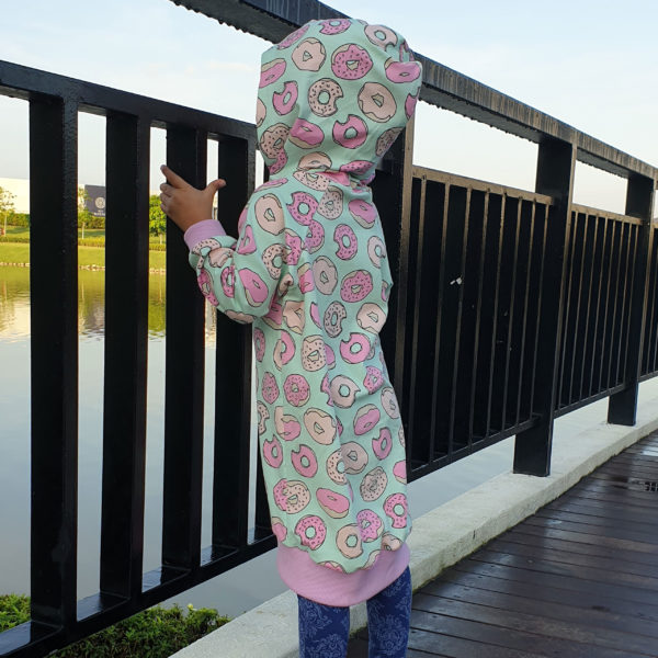Learn how to make a cute, cozy and easy-to-sew childrens hoodie dress that is the ultimate in casual comfort. Comes in sizes 12 months to 12 years