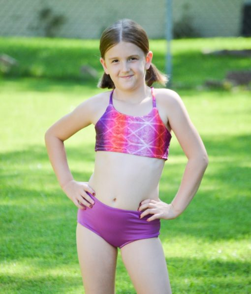 Mix and match your favorite options for a gorgeous two-piece swimsuit. This childrens two piece swimsuit sewing pattern has a high back top and ruched bottoms.