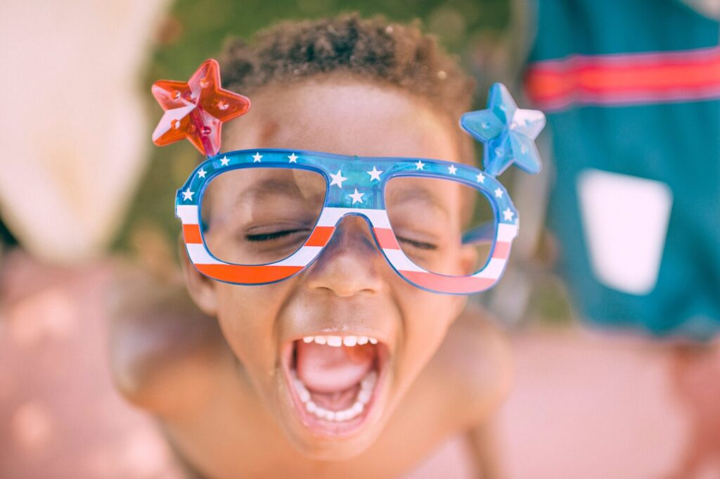 Kid wearing 4th of July glasses