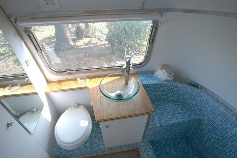 Sustainable Custom Cut Countertops And Glass Tile In The Airstream Bathroom