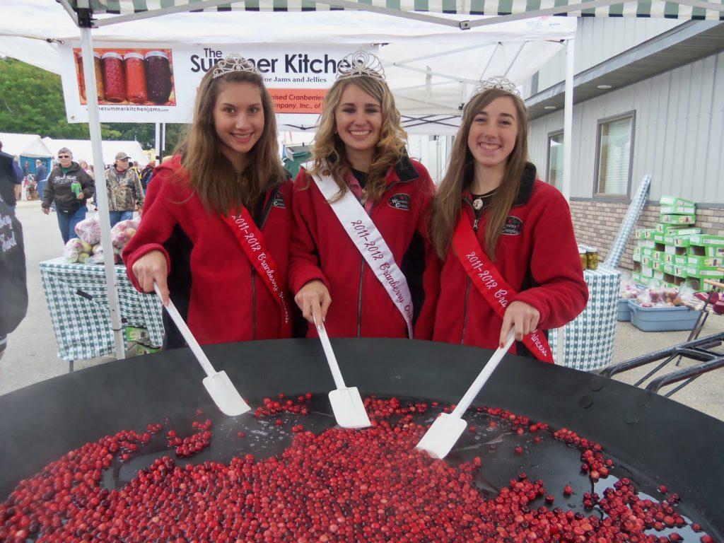Cranberry fall festival: girls stirring cranberries