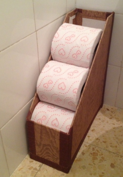 Ordinaire Store Extra Toilet Paper In The Magazine Holder