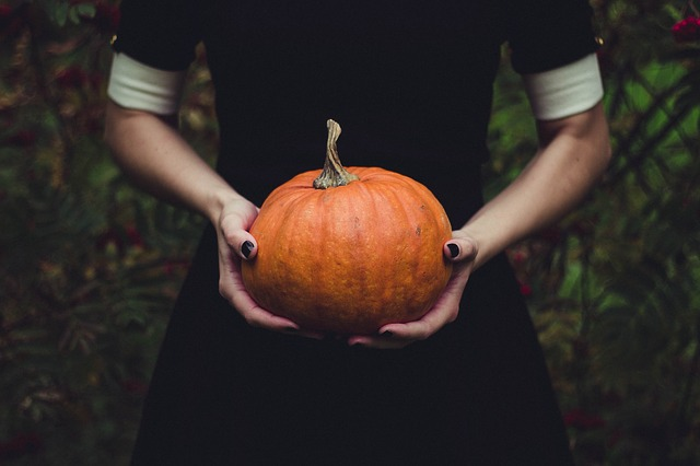 Lady holding pumpkin
