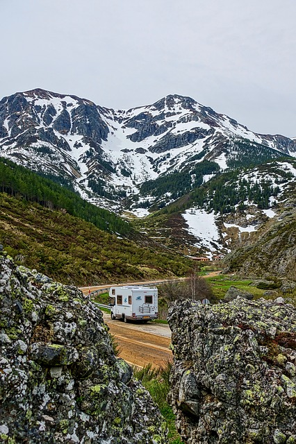 Camper on winding road through mountains
