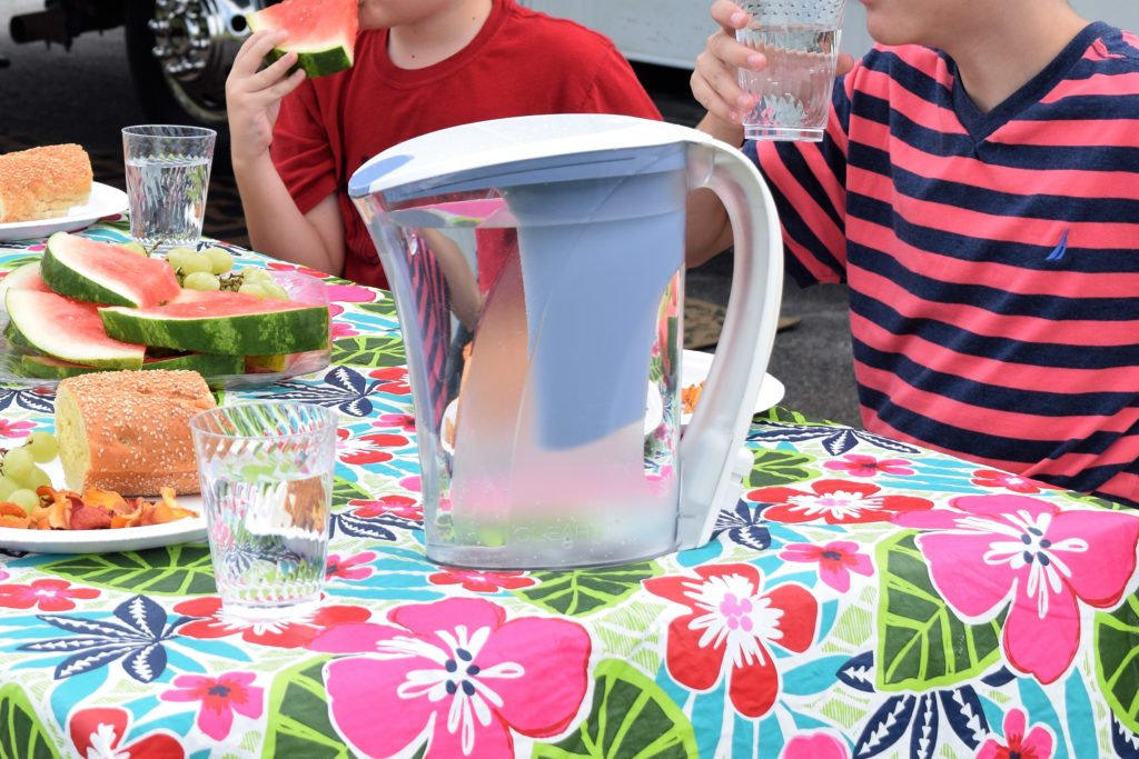 Water filter pitcher on picnic table