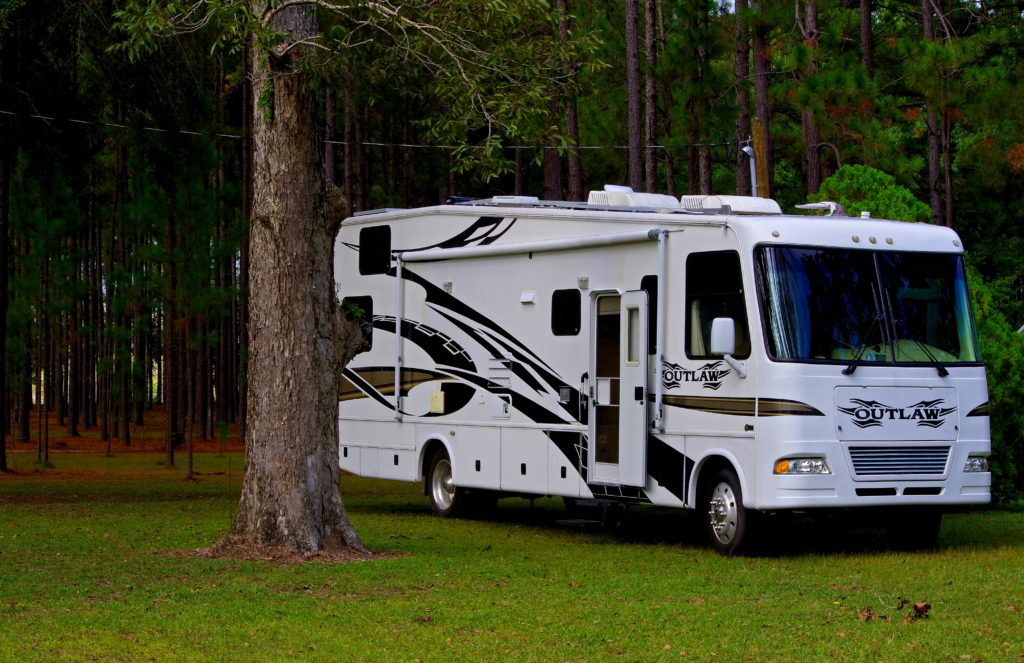 RV parked to camp in the woods