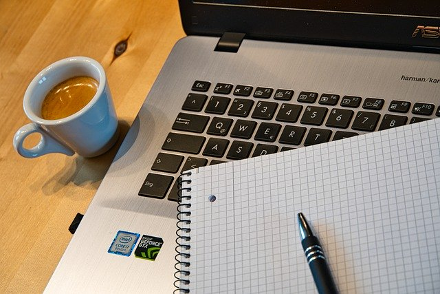 a computer, coffee, and work from home supplies