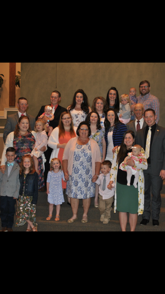 Family photo with about 20 people of all ages