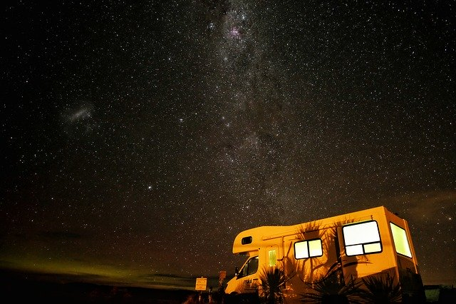 RV set up at night under the stars