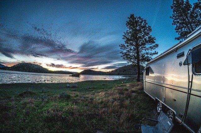 Airstream camping by lake